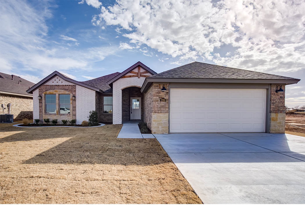 Exterior of beautiful new Lubbock home for sale by Sharkey Custom Homes.