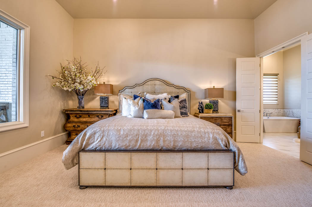 Detail of spacious bedroom in home by Sharkey Custom Homes.