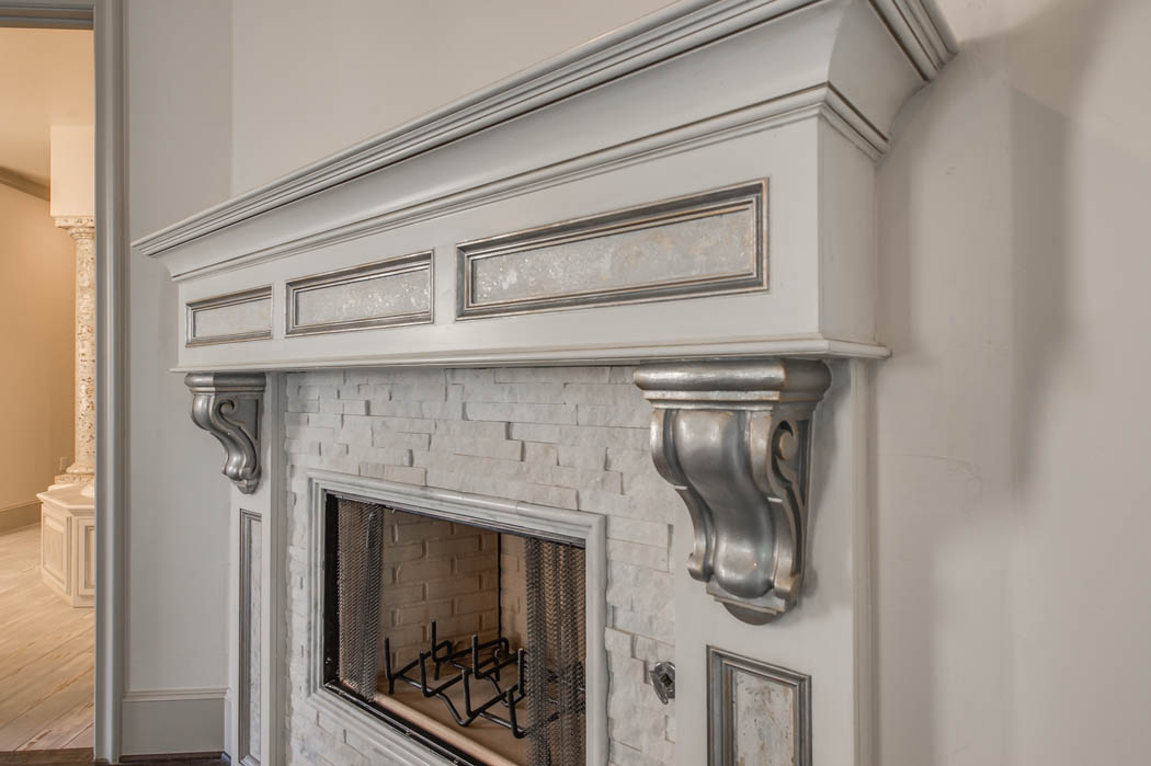 Detail of beautiful fireplace in custom Lubbock home.