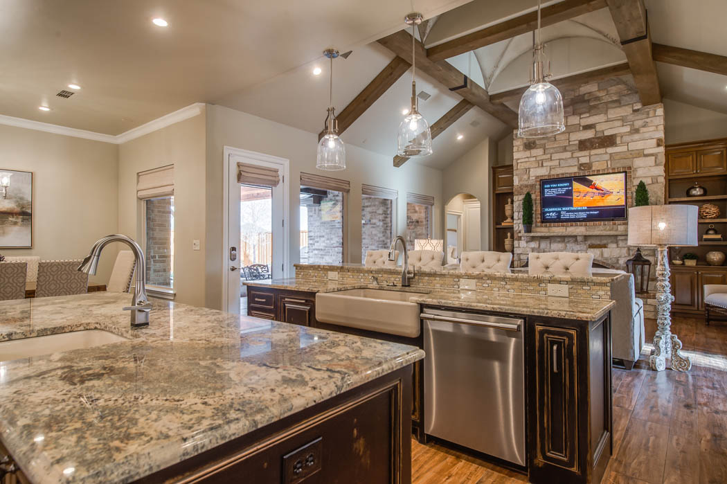 Spacious kitchen with wonderful detail in custom home in the Lubbock area.